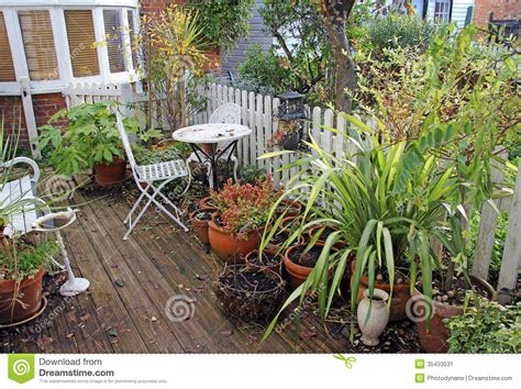 cottage garden sheds potted plants for all seasons winter country cottage garden stock image image 35433531