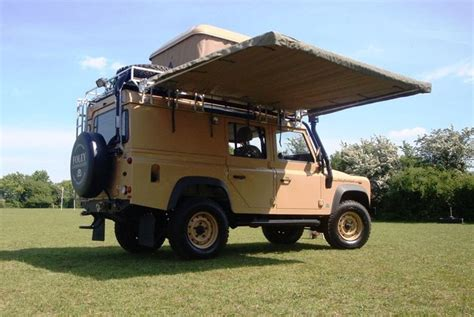 Road Vehicle Awnings by An Overland Vehicle Prepared With An Awning For