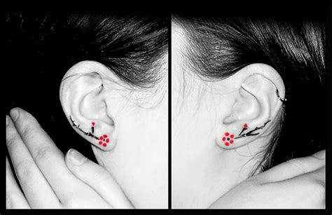 fine cherry blossom flowers ear tattoo