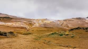 Mountains, geyser, stones, grass, steam Wallpaper