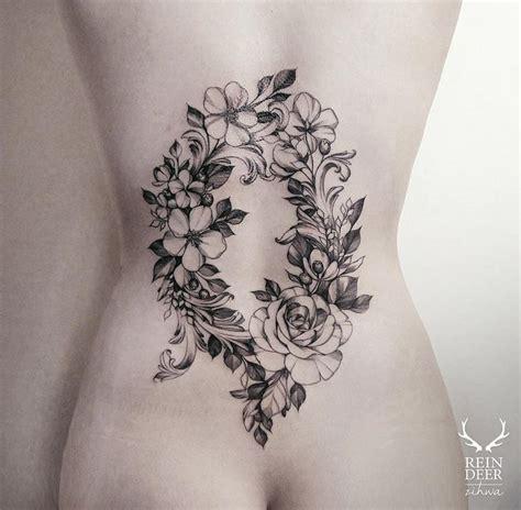 tattoo flower wreath floral wreath on girls lower back best tattoo ideas