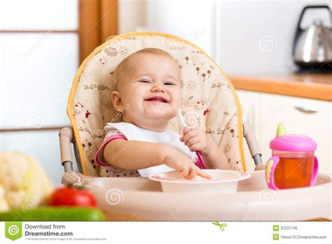 Design A Plan by Baby Eating Healthy Food On Kitchen Royalty Free Stock