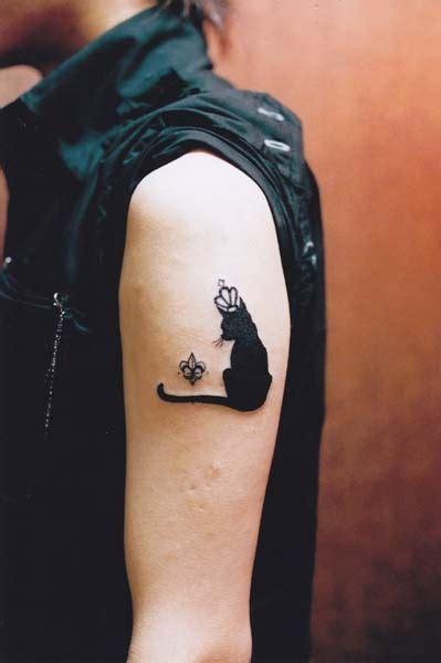 cat king tattoo smart black cat king style tattoo on arm tattoomagz