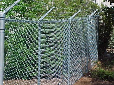 proof chain link fence pet proofing what can i do to a chain link fence to make it proof home