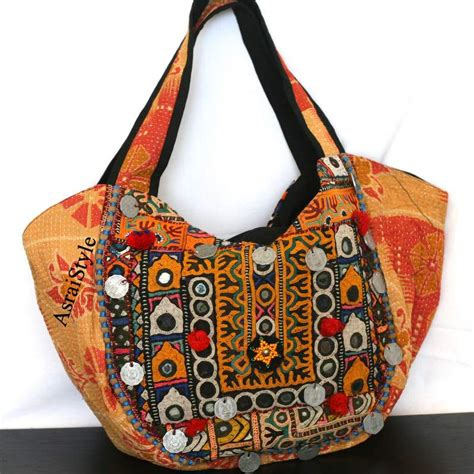 Handmade Cloth Purses - superb designs of exclusive fabric stuffed handbags for