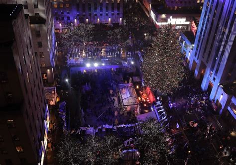 rockefeller center christmas tree lights up new york city