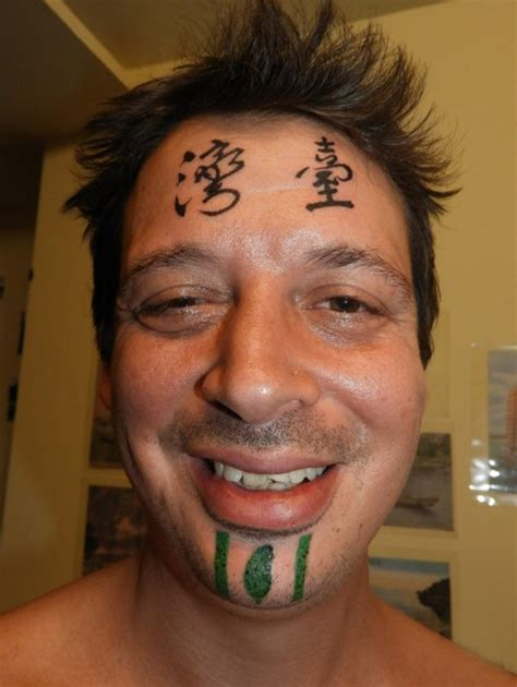 taiwan tattoo with taiwan on his forehead arrested
