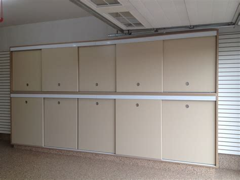 garage organization calgary slotwall epoxy floor custom cabinets sliding doors