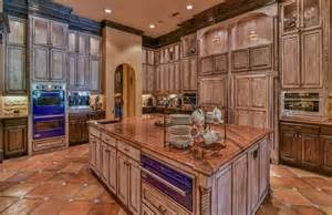 Spanish For Floor traditional kitchen with spanish tile floor and red granite counters