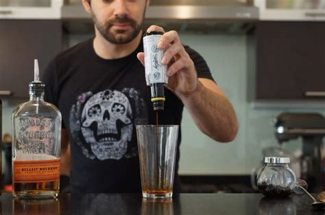 how to make a manhattan drink step 1 of 9 add 2 3 heavy dashes bitters to a pint glass