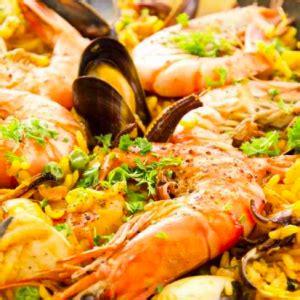 come si cucina la paella di pesce come cucinare la paella di pesce la ricetta tecnichef