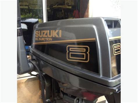 8 hp suzuki 2stroke outboard less then 10 hrs outside