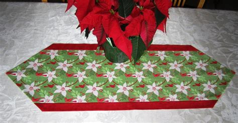 table runners and potholders on quilted table