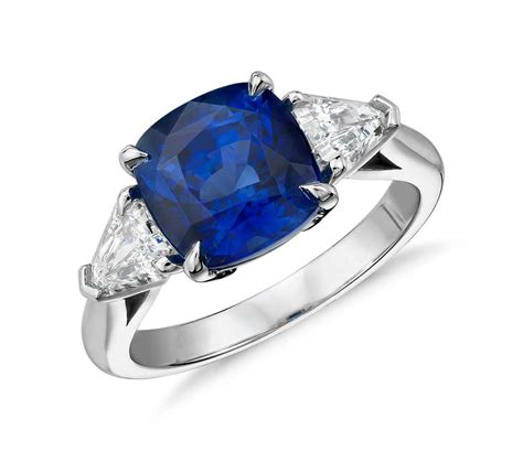 cushion cut sapphire and three ring in