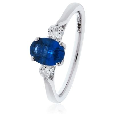 Blue Sapphire 4 35ct 1 35ct oval blue sapphire trilogy ring