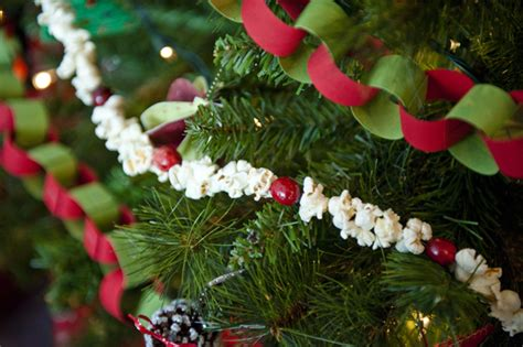 stringing popcorn for christmas december 13th is national popcorn string day foodimentary national food holidays