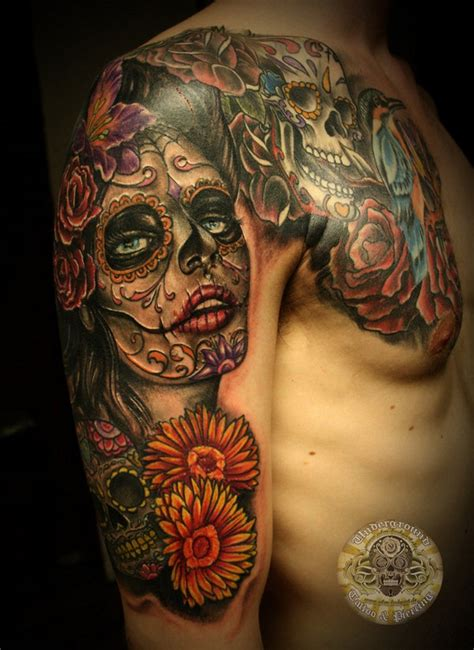 arm and chest tattoo santa muerte with mexican sugar skulls on arm and
