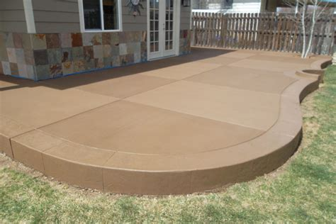sandstone colored concrete patio sted concrete