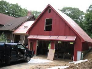 garage door overhangs shed awning on side