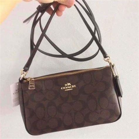 Coach Sling Backpack 2 sale coach two way sling bag s fashion bags wallets on carousell