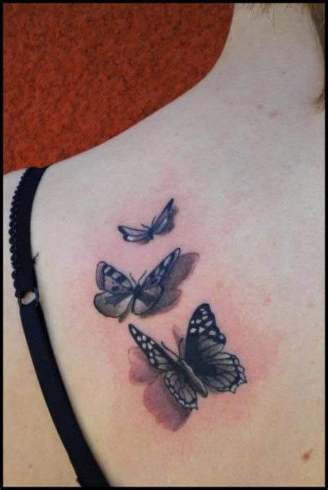 divinity tattoo shoulder realistic butterfly by divinity