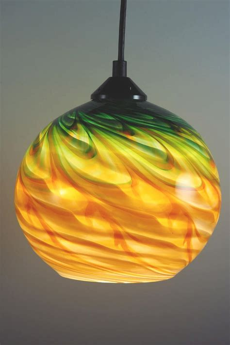large glow in the blown glass globe green gold and green optic globe pendant by rosenbaum glass pendant l artful home