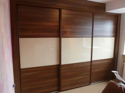 Wardrobe Wooden Sliding Doors by Wood Effect Wardrobe Designs Nottingham Sliding Doors