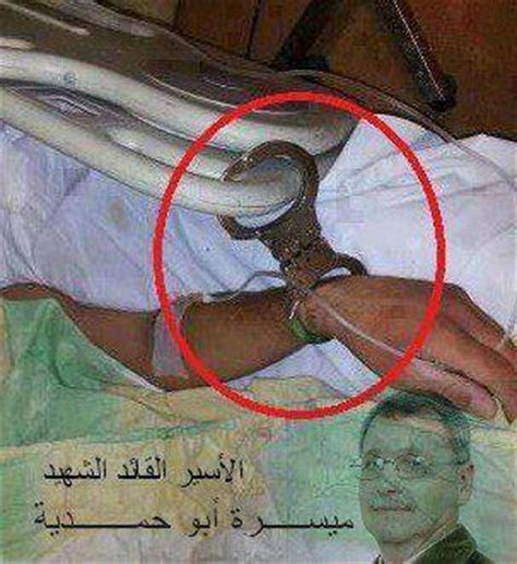 handcuffed to the bed palestinians busted faking photo allegedly showing palestinian prisoner handcuffed to