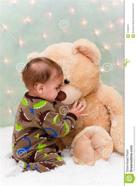 Pjhb85864 Pajamas Hug A Baby baby in pajamas teddy royalty free stock