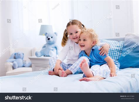 play in the bedroom happy white bedroom stock photo 444131860