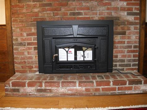 jotul wood stove insert installed in fireplace from