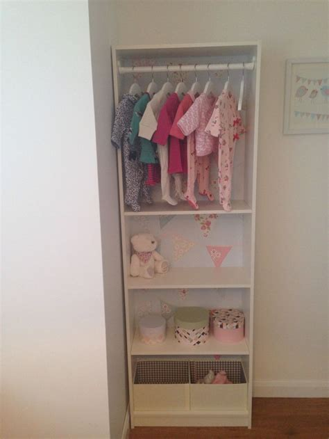 open closet made from an ikea gersby bookcase bunting