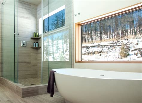 groutless tile bathroom with bathtub window