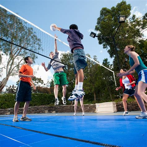 backyard sport games group of kids playing volleyball on outdoor sport court