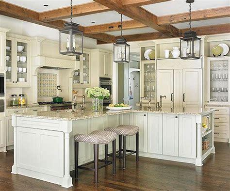 glittering custom kitchen island designs of white river a trio of oversize lanterns ground this cream color