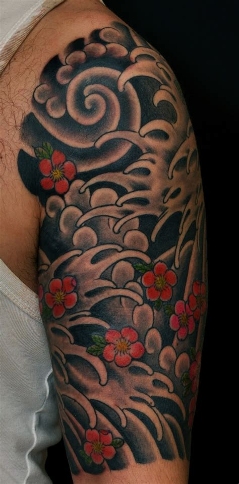 japanese waves tattoo dadan horton water and cherry blossom