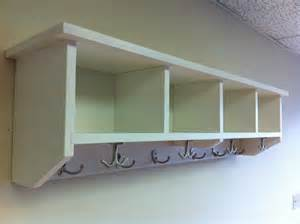 entryway shelf with cubbies and coat hooks by