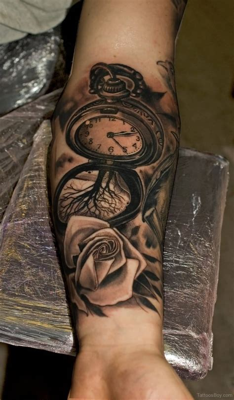 left arm tattoos watercolor clock on right forearm