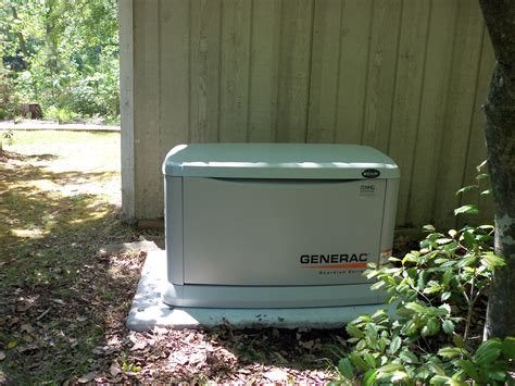 generac whole house generator generac 20 kilowatt whole house generator installed on a preformed concrete pad by