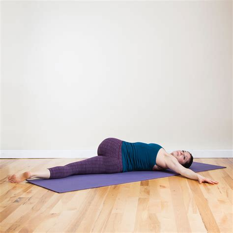 reclined spinal twist yoga poses you can do in bed popsugar fitness