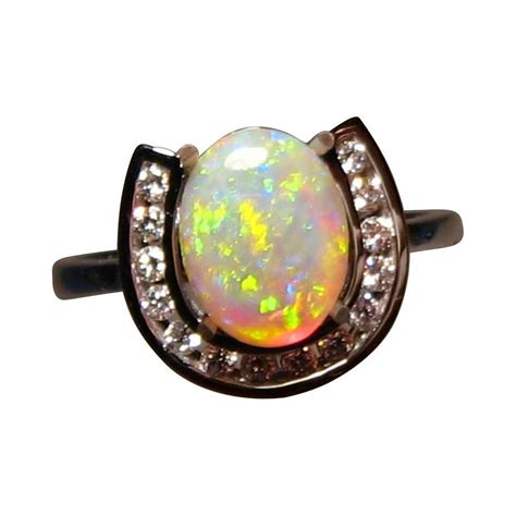 opal ring with horseshoe 14k gold flashopal