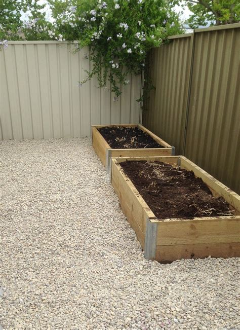 Planters On Fence by Straw Bale Planter Boxes Along Fence Garden Planter