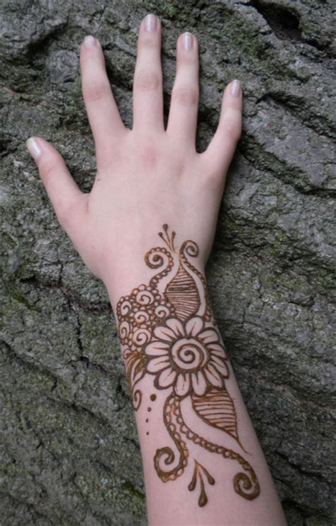 swirl wrist tattoos henna swirl flower on wrist by flowerwills on deviantart