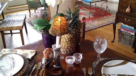 table setting for pad thai dinner with baked pineapple