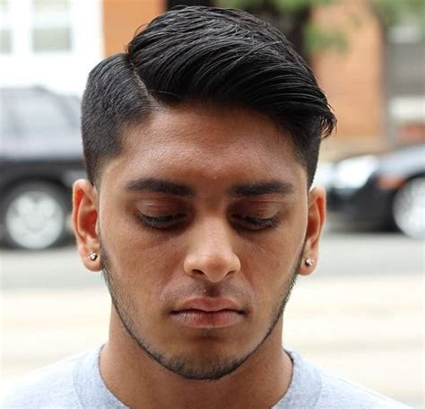 hair under cut with tapered side men s regular cut with tapered sides and side part on dark