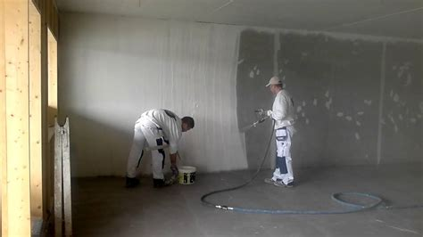 plastering basement walls spray plastering concrete wall getting ready for painting