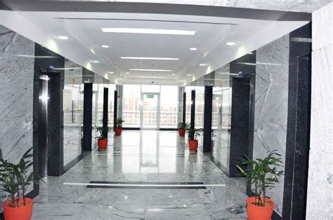 themes communications pvt ltd gurgaon corridor with granite flooring designed by horizon design