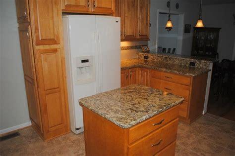 metro cabinets granite creations maple butterscotch cabinets venetian gold granite