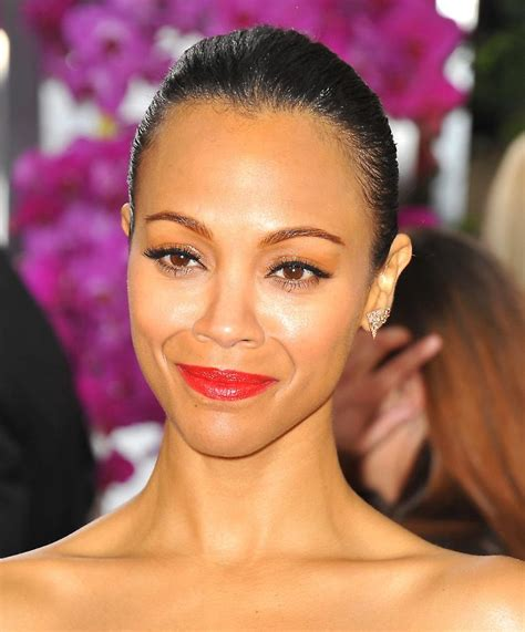 Premium Dvd Starring Zoe Saldana Hill In Stores Now by Zoe Saldana At Arrivals For 71st Golden Globes Awards