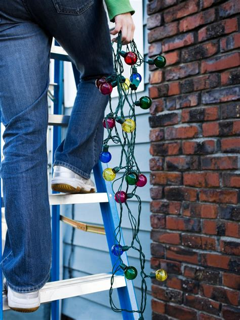 how to hang christmas lights on brick wall how to hang lights diy